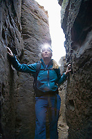 Woman hiking narrow passageway Vantage Washington USA&#xA;<br />