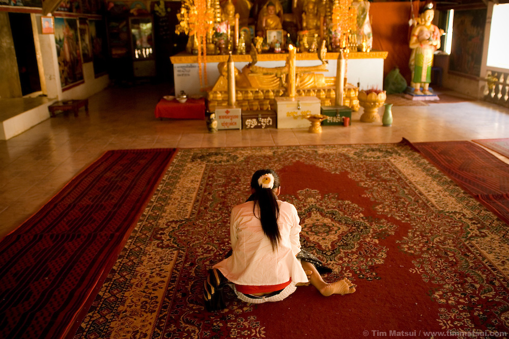 Sex trafficking survivor Srey Neth at the Oudom Pagoda, a place where her surrogate mother, Transitions Global Director Jaya Sry helped her find herself. Sry, a survivor of the genocidal Khmer Rouge, helps the young women learn to forgive and love again.