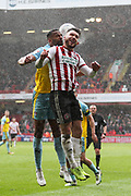 Sheffield United forward Gary Madine (14) and Rotherham United defender Michael Ihiekwe (20) challenge for the ball during the EFL Sky Bet Championship match between Sheffield United and Rotherham United at Bramall Lane, Sheffield, England on 9 March 2019.