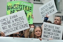 July 4, 2017 - Krakow, Poland - Activists and protesters from 'Love Primeval Forest of Bialowieza' during a protest in front of ICE Congress Center where the 2017 World Heritage Committee sessions are host..On Tuesday, July 4, 2017, in Krakow, Poland. (Credit Image: © Artur Widak/NurPhoto via ZUMA Press)