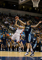 Old Dominion forward/center Megan Pym (44) blocks a shot by Virginia guard Britnee Millner (12).  The #11 ranked / #5 seed Old Dominion Lady Monarchs defeated the #24 ranked / #4 seed Virginia Cavaliers 88-85 in overtime in the second round of the 2008 NCAA Women's Basketball Championship at the Ted Constant Convocation Center in Norfolk, VA on March 25, 2008.