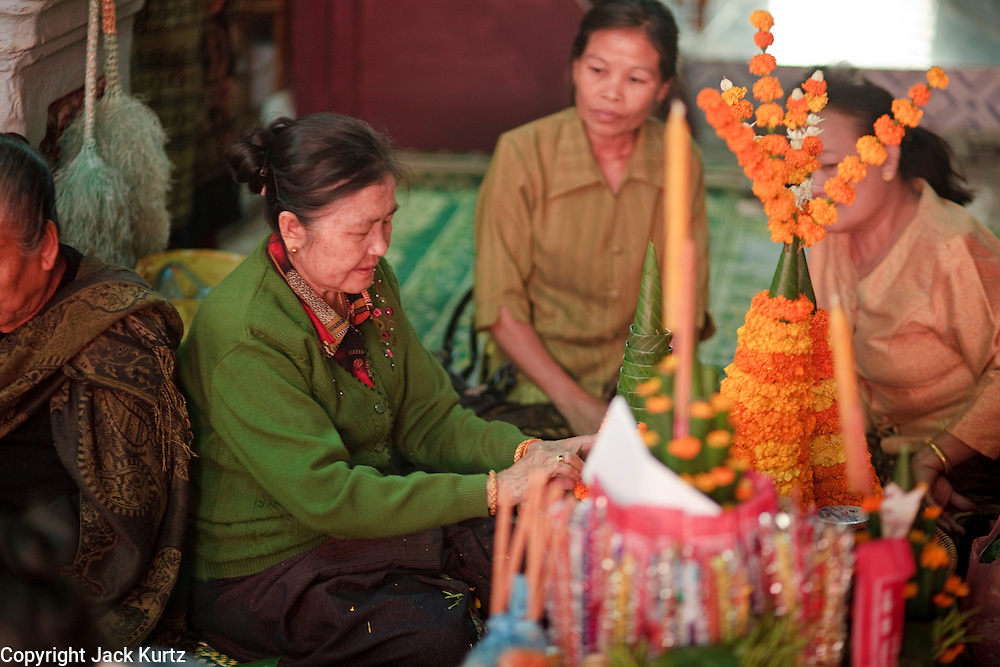 Mar. 15, 2009 -- LUANG PRABANG, LAOS: Women make table centerpieces and decorations for a wedding in Luang Prabang, Laos.  Photo by Jack Kurtz