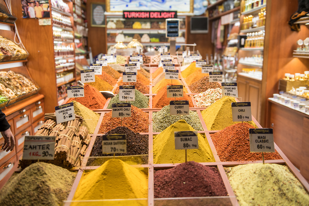 Copious bins in market stall at Istanbul Spice bazaar in Turkey present shoppers with colorful spices on display for sale