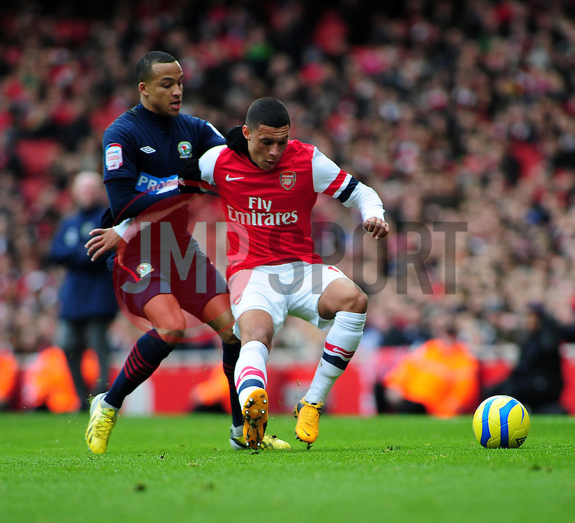 Arsenal's Alex Oxlade-Chamberlain shields the ball from Blackburn Rovers' Marcus Olsson - Photo mandatory by-line: Dougie Allward/JMP - Tel: Mobile: 07966 386802 16/02/2013 - SPORT - FOOTBALL - Emirates Stadium - London -  Arsenal V Blackburn Rovers - FA Cup - Fifth Round
