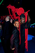 YAOUROU KONATE, Grey Goose character and cocktails. The Elton John Aids Foundation Winter Ball. off Nine Elms Lane. London SW8. 30 October 2010. -DO NOT ARCHIVE-© Copyright Photograph by Dafydd Jones. 248 Clapham Rd. London SW9 0PZ. Tel 0207 820 0771. www.dafjones.com.