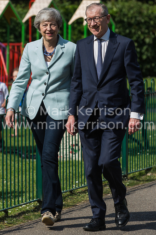 Sonning, UK. 23 May, 2019. Prime Minister Theresa May arrives at her local polling station with her husband Philip to vote in the European elections.