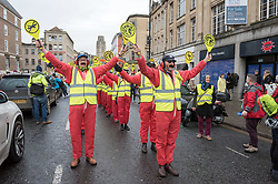"""© Licensed to London News Pictures. 31/01/2020. Bristol, UK. The """"Bristol Area Landing Crew"""" at the """"No Bristol Airport Expansion"""" march and rally in the city centre, organised by Bristol Airport Action Network (BAAN) and Extinction Rebellion Bristol. Bristol Airport, which is situated in North Somerset, has plans to increase capacity for 12 million passengers a year, up from its current capacity of 10 million by 2026, and their application is due to be considered at a special meeting of North Somerset's Planning and Regulatory Committee on February 10 at 6pm. North Somerset Council officers have recommended the application be approved despite more than 5,400 objections and around 2,200 letters of support. Objections have highlighted the detrimental effects for the local communities including increased air and noise pollution, increased traffic congestion and the loss of Greenbelt land around the airport, but the urgent need to tackle climate change is one of the main reasons why people are objecting. Photo credit: Simon Chapman/LNP."""
