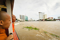Buddhist Monks ride on public transportation Chao Phraya River Bangkok,Thailand.