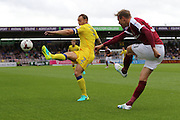 Northampton Town midfielder Matthew Taylor (31) clears before AFC Wimbledon defender & captain Barry Fuller (2) during the EFL Sky Bet League 1 match between Northampton Town and AFC Wimbledon at Sixfields Stadium, Northampton, England on 20 August 2016. Photo by Stuart Butcher.