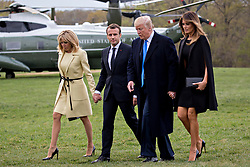 U.S. First Lady Melania Trump, from right, U.S. President Donald Trump, Emmanuel Macron, France's president, and Brigitte Macron, France's first lady, arrive from Marine One at the Mount Vernon estate of first U.S. President George Washington in Mount Vernon, Virginia, U.S., on Monday, April 23, 2018. As Macron arrives for the first state visit of Trump's presidency, the U.S. leader is threatening to upend the global trading system with tariffs on China, maybe Europe too, and to ditch the Iran nuclear accord. Photographer: Andrew Harrer/Bloomberg