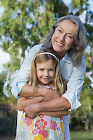 Portrait of grandmother with granddaughter (5-6) smiling