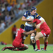 "Ben Mowen barges into the tackles of Will Genia (left) and James Hanson (right) during the Super 15 Rugby Union match (Round 7) between the Queensland Reds and the ACT Brumbies played at Suncorp Stadium (Brisbane, Australia) on Good Friday 6th April 2012 ~ Queensland (20) defeated the Brumbies (13) ~ This image is intended for Editorial use only - Required Images Credit ""Steven Hight - Aura Images"""