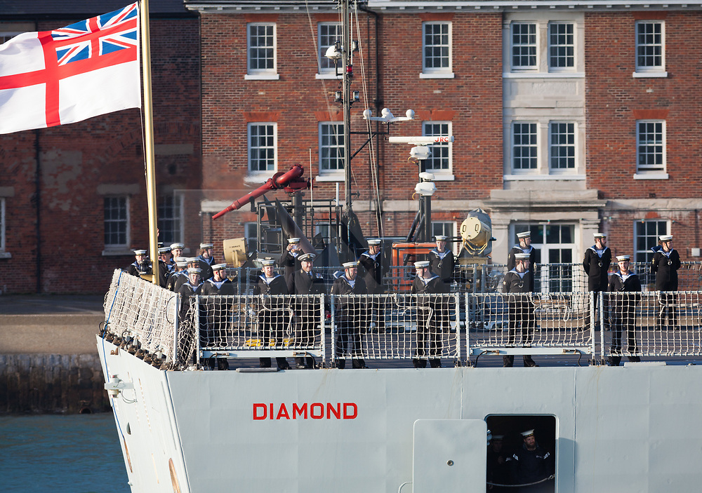 © Licensed to London News Pictures. 01/12/2017. Portsmouth, UK.  Crew members aboard the troubled Royal Navy Type-45 Destroyer, HMS Diamond, as she returns to Portsmouth with a tug escort following 'technical issues'. The £1 billion Daring-class warship has returned home early from her patrol on Operation Kipion in the Gulf. Photo credit: Rob Arnold/LNP