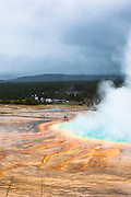Steam erupts from Grand Prismatic Spring, Yellowstone National Park, Wyoming. The largest hot spring in the United States, it's also the world's third largest, with a diameter of 90m, and a depth of some 50m. The colours are thanks to pigmented bacteria growing in the microbial mats that surround the spring water, which is full of minerals.