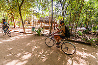 Tourists bicycling through the Coba archaeological site, Riviera Maya, Mexico