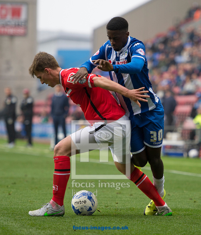 Jordy Hiwula of Wigan Athletic (right) is blocked off by Paul Downing of Walsall (left) during the Sky Bet League 1 match at the DW Stadium, Wigan<br /> Picture by Russell Hart/Focus Images Ltd 07791 688 420<br /> 03/10/2015