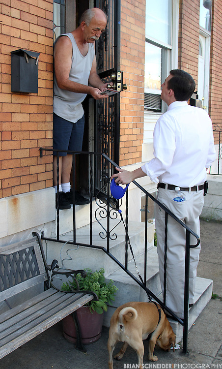 July 1, 2010; Baltimore, MD, USA; Maryland State Senate candidate Bill Ferguson campaigns in the Upper Fells Point neighborhood of the 46th District in Baltimore, MD. Ferguson is a former Baltimore City public school teacher who is running his first campaign against George W. Della Jr. a 27-year incumbent. Mandatory Credit: Brian Schneider-www.ebrianschneider.com