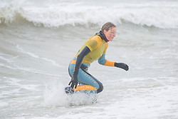 © Licensed to London News Pictures. 10/03/2018. Brighton, UK. Members of the Brighton Surf Life Saving Club brave the cold sea water to take part in their weekly training session in Brighton and Hove. Photo credit: Hugo Michiels/LNP