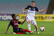 SYDNEY, AUSTRALIA - APRIL 27: Western Sydney Wanderers forward Bruce KamauÊ(11) slides to tackle Melbourne Victory defender Leigh Brougham (6) at round 27 of the Hyundai A-League Soccer between Western Sydney Wanderers FC and Melbourne Victory on April 27, 2019 at ANZ Stadium in Sydney, Australia. (Photo by Speed Media/Icon Sportswire)