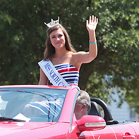 Miss North Carolina's Outstanding Teen 2014 Karson Fair waves to spectators during the North Carolina 4th of July Festival Parade Friday July 4, 2014 in Southport, N.C.