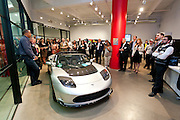 Michael Sexton, Tesla Motors addresses guests at the MCC Transportation Transformation Series: Opening Reception at Tesla Showroom held  May 11, 2011 at Tesla Motors New York, 511 West 25th Street, New York. This exciting series was presented by MCC's Green Business Committee, MCC's Tech and Innovation Committee and E3NYC. The MCC offers the business community a variety of perspectives of the direction of clean transportation in New York and beyond. The Tesla Roadster is the world's only automobile that offers supercar performance without supercar emissions. Engineered for performance and efficiency, it accelerates from 0 to 60 in 3.7 seconds, delivering 295 lbs-ft. of torque without using a drop of gasoline. The Roadster travels 245 miles on a single charge and plugs into nearly any outlet in the world - allowing for uncompromised electric driving. The event was sponsored by Con Edison Commercial & Industrial Energy Efficiency Programs for sponsoring the MCC Green Business Committee for 2011.