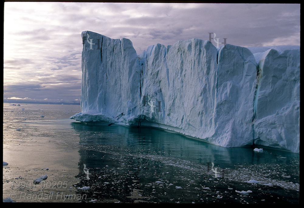 Towering iceberg calved from Ilulissat Kangerlua Icefjord drifts northward in Disko Bay on an August afternoon; Greenland