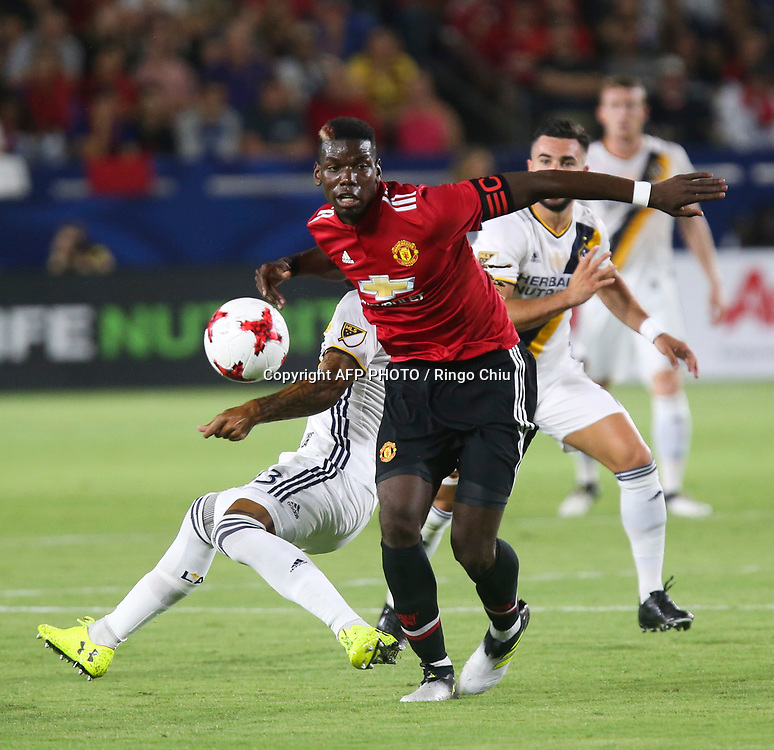 Manchester United Paul Pogba controls the ball against Los Angeles Galaxy  during the second half of a national friendly soccer game at StubHub Center on July 15, 2017 in Carson, California. The Manchester United won 5-2. AFP PHOTO / Ringo Chiu