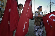 ISTANBUL, TURKEY - 22-11-2003: People selling Turkish flags at Taksim square in Istanbul a few days after the bombings on the British embassy and the HSB bank on November 20. The bombings have stronged the feelings of nationalism amongst the Turkish citizins.