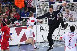 Tomasz Tluczynski (19) of Poland vs Goalkeeper  of Denmark Nikla Landin Jacobsen during 21st Men's World Handball Championship 2009 Bronze medal match between National teams of Poland and Denmark, on February 1, 2009, in Arena Zagreb, Zagreb, Croatia.  Won of Poland 31:23. (Photo by Vid Ponikvar / Sportida)