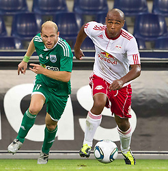 25.08.2011, Red Bull Arena, Salzburg, AUT, UEFA EL, Red Bull Salzburg vs Omonia Nikosia, im Bild Andreas Avraam, (Omonia Nikosia) vs Leonardo  (Red Bull Salzburg, #30) // during the UEFA Europaleague 2nd Leg Match, Red Bull Salzburg against Omonia Nikosia, Red Bull Arena, Salzburg, 2011-08-25, EXPA Pictures © 2011, PhotoCredit: EXPA/ J. Feichter