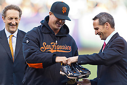 SAN FRANCISCO, CA - JUNE 26: Matt Cain #18 of the San Francisco Giants (center) hands the spikes worn during his perfect game pitched on June 13, 2012, to National Baseball Hall of Fame president Jeff Idelson (right) before the game against the Los Angeles Dodgers at AT&T Park on June 26, 2012 in San Francisco, California. The spikes and other items will be on display in Cooperstown, NY.  (Photo by Jason O. Watson/Getty Images) *** Local Caption *** Matt Cain; Jeff Idelson