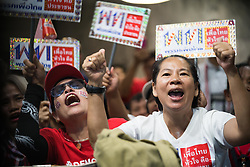 March 24, 2019 - Bangkok, Thailand - Supporters of the Pheu Thai Party celebrate as one of their candidates wins a seat as they watch the live polling results on TV in the Pheu Thai Party headquarters..The people of thailand is waiting for the final election result as the polling station has closed and cotes are being counted. (Credit Image: © Geovien So/SOPA Images via ZUMA Wire)