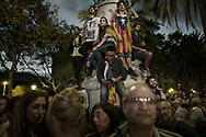 Pro-independence supporters stand in dismay after they heard Catalan President Carles Puigdemont announced he will abide by the independence vote but suspend it's implementation as they watch his address on big screens outside the Parliament, on October 10, 2017 in Barcelona, Spain.