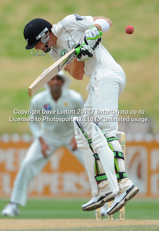 NZ batsman Martin Guptill gets hit by a bouncer from Wahab Riaz. 2nd cricket test match - New Zealand Black Caps v Pakistan, day four at the Basin Reserve, Wellington, New Zealand on Tuesday, 18 January 2011. Photo: Dave Lintott / photosport.co.nz