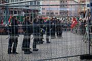 Frankfurt am Main | 30 Mar 2015<br /> <br /> Am Montag (30.03.2015) demonstrierten etwa 40 Menschen unter dem Namen &quot;Freie B&uuml;rger f&uuml;r Deutschland&quot; auf dem R&ouml;merberg in Frankfurt am Main gegen Islamisierung und zahlreiche andere &Uuml;bel, die Gruppe war zuvor unter dem Namen &quot;PEGIDA&quot; aufgetreten. Etwa 600 Menschen protestierten lautstark gegen diese Kundgebung.<br /> Hier: Polizeibeamte bewachen Gegendemonstranten an einer Absperrung.<br /> <br /> &copy;peter-juelich.com<br /> <br /> [No Model Release | No Property Release]