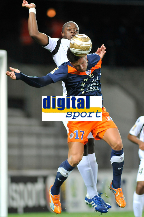 FOOTBALL - FRENCH LEAGUE CUP 2011/2012 - 1/8 FINAL - MONTPELLIER HSC v FC LORIENT - 26/10/2011 - PHOTO SYLVAIN THOMAS / DPPI - OLIVIER GIROUD (MON) / LAMINE KONE (LOR)