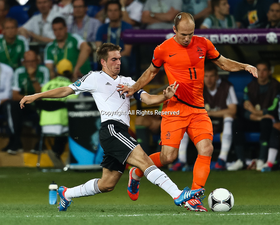 13.06.2012 Ukraine, Kharkiv : Ukraine, Kharkiv.  Netherlands national team player Arjen Robben and German national team player Philipp Lahm (L) in the group stage European Football Championship match between teams of the Netherlands and Germany.
