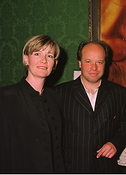 Artist PAUL KARSLAKE and MRS PAUL KARSLAKE at an exhibition in London on 14th July 1998.MJB 5