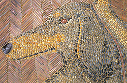 Detail of pebble mosaic at Great Dixter showing head of Christopher Lloyd's dachshund dog called Canna
