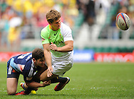 LONDON, ENGLAND - Saturday 10 May 2014, Kwagga Smith of South Africa gets the ball away before Steeve Barry of France can get hold of it during the match between South Africa and France at the Marriott London Sevens rugby tournament being held at Twickenham Rugby Stadium in London as part of the HSBC Sevens World Series.<br /> Photo by Roger Sedres/ImageSA