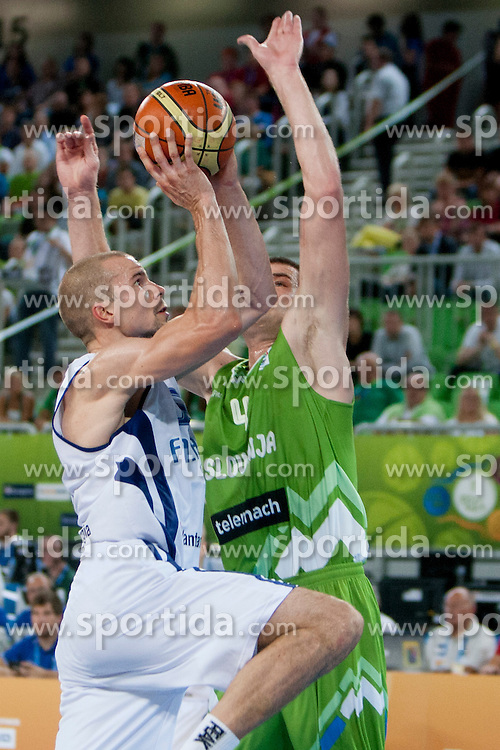 Uros Slokar of Slovenia during basketball match between National teams of Finland and Slovenia in 2nd Round at Day 13 of Eurobasket 2013 on September 14, 2013 in SRC Stozice, Ljubljana, Slovenia. (Photo By Urban Urbanc / Sportida)