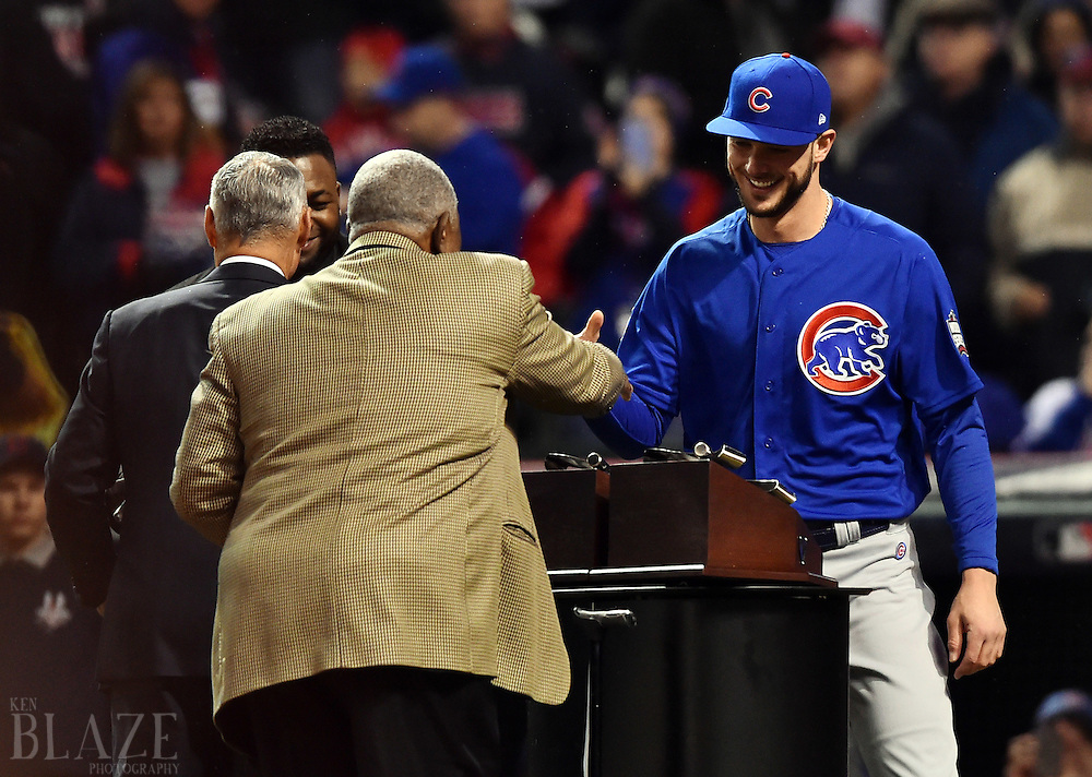 Oct 26, 2016; Cleveland, OH, USA; Chicago Cubs third baseman Kris Bryant (right) and Boston Red Sox player David Ortiz shake hands with MLB commissioner Rob Manfred and hall of famer Hank Aaron before game two of the 2016 World Series between the Cubs and the Cleveland Indians at Progressive Field. Mandatory Credit: Ken Blaze-USA TODAY Sports