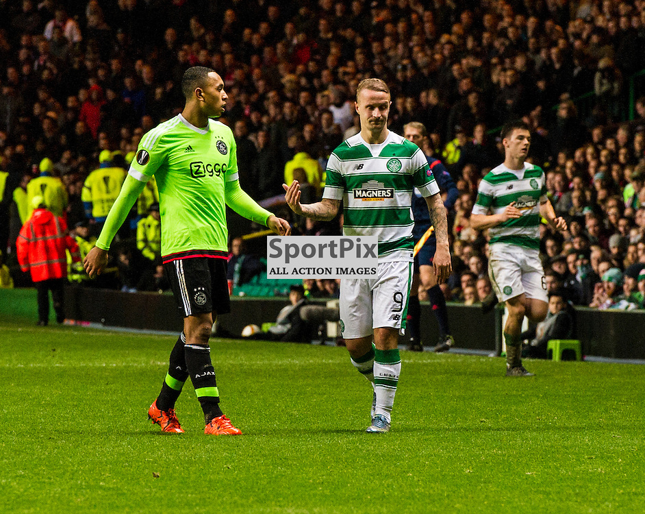 Leigh Griffiths looks to his teamamtes to get closer under the watchful eye of Kenny Tete as Celtic host Ajax at Parkhead in the Europa League.<br /> &copy; Ger Harley/ SportPix.org.uk 26 November 2015