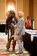 ORLANDO, FL - AUGUST 14:  Celebrity impersonators Walter Rozenski, (L) and Steve Crews chat during the Sunburst Convention of Celebrity Tribute Artists in Orlando, Florida, August 14, 2009. The annual convention offers the artists an opportunity to perform for agents and other talent buyers. (Photo by Matt Stroshane/Getty Images)