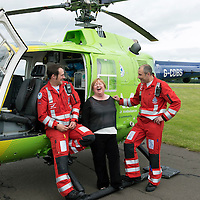 SCAA...Scotland's Charity Air Ambulance Paramedics re-united with first casualty....26.06.13<br /> 59 year old Patricia MacKenzie from Thornliebank in Glasgow visited the base of Helimed 76 in perth today to thank the two paramedics John Pritchard (right) and Wayne Auton who airlifted Patricia to hospital after her accident near Cairndow in Argyll five weeks ago.<br /> Picture by Graeme Hart.<br /> Copyright Perthshire Picture Agency<br /> Tel: 01738 623350  Mobile: 07990 594431