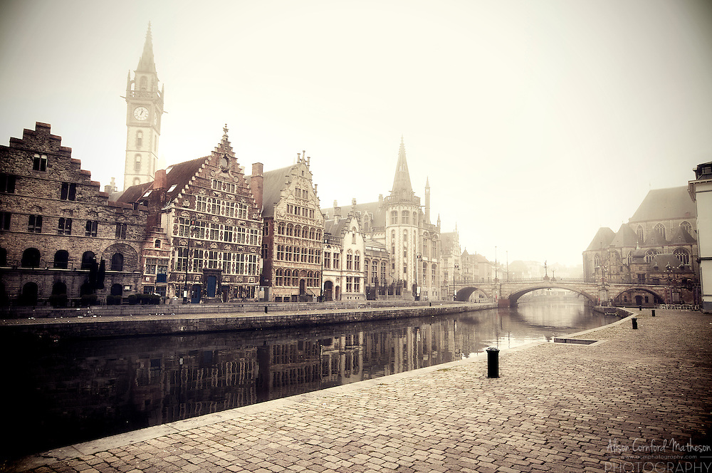 A misty morning on Ghent's Graslei waterfront, in Flanders, Belgium