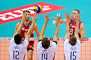(R) Alexey Spiridinov from Russia spikes the ball during the 2013 CEV VELUX Volleyball European Championship match between Russia v Slovakia at Ergo Arena in Gdansk on September 24, 2013.<br /> <br /> Poland, Gdansk, September 24, 2013<br /> <br /> Picture also available in RAW (NEF) or TIFF format on special request.<br /> <br /> For editorial use only. Any commercial or promotional use requires permission.<br /> <br /> Mandatory credit:<br /> Photo by &copy; Adam Nurkiewicz / Mediasport