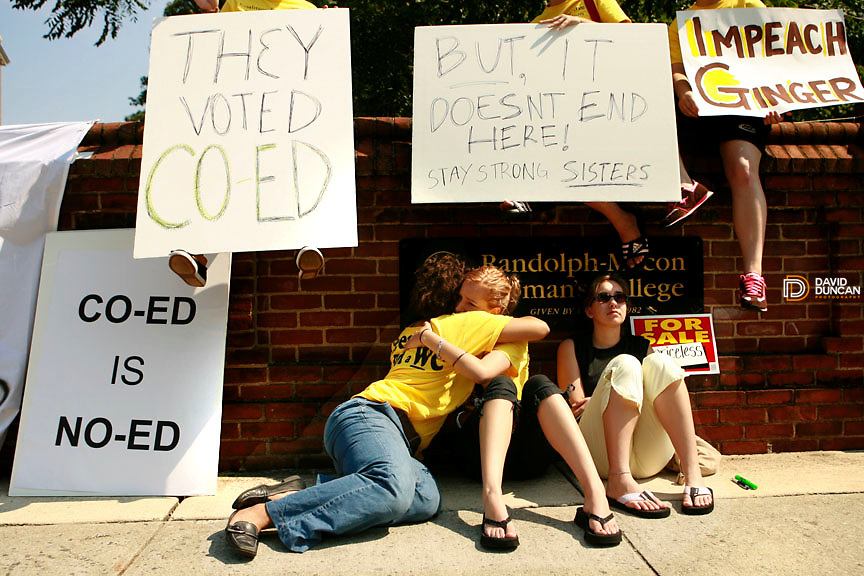 Randolph-Macon Woman's College students sit outside the gates in Lynchburg, VA holding signs and each other after the Jolley Christman, President of the Board of Trustees at Randolph-Macon Woman's College announced Saturday August 9, 2006  that the all woman's college would admit men in 2007..Photo by David Duncan.