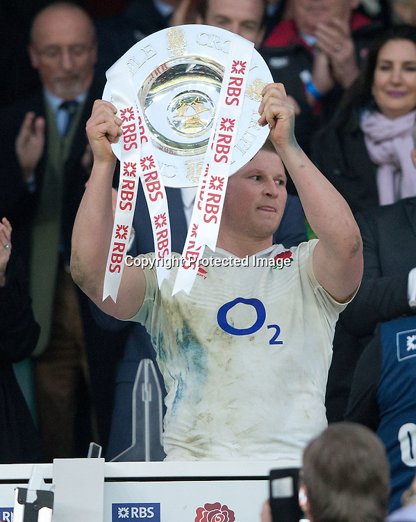 RBS 6 Nations Championship Round 4, Twickenham Stadium, London, England 12/3/2016<br /> England vs Wales<br /> England's Dylan Hartley lifts the Triple Crown presented by Prince Harry<br /> Mandatory Credit &copy;INPHO/Andrew Fosker