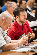 Delegates work with the voting materials during the 66th Regular Convention of The Lutheran Church–Missouri Synod on Sunday, July 10, 2016, at the Wisconsin Center in Milwaukee. LCMS/Michael Schuermann